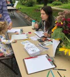 Emily Moorhead-Wallace assisting community draw, Eco-Sketch